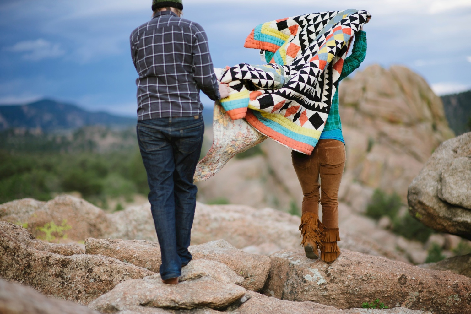Couple walking away with a blanket // Photos by Maddie Mae Photography