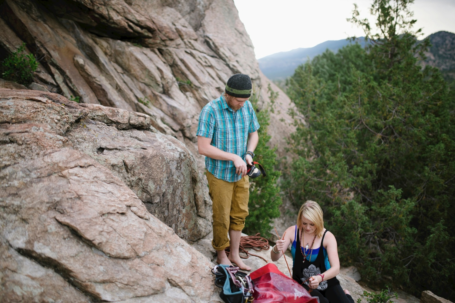 This couple goes rock climbing for their engagement photoshoot! Photos by Maddie Mae Photography