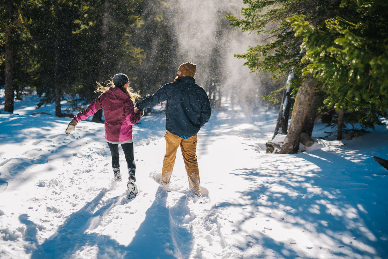 Epic snowshoeing engagement session for adventurous couples. Winter in the Colorado Mountains is harsh but beautiful. St. Mary's Glacier Engagement session by Maddie Mae Photography