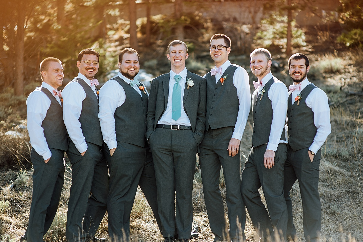 I love the light pink and tiffany blue wedding color scheme for the groomsmen. Such a nice mountain wedding in Estes Park, Colorado.Photo by Maddie Mae Photography