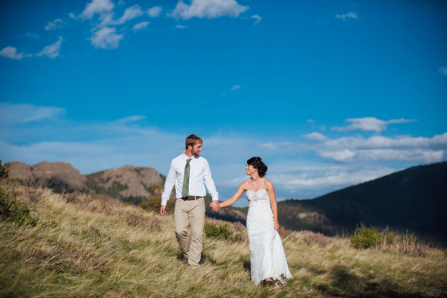 I love these Colorado blue skies and rocky mountains especially for a wedding shoot! Photo by Maddie Mae Photography