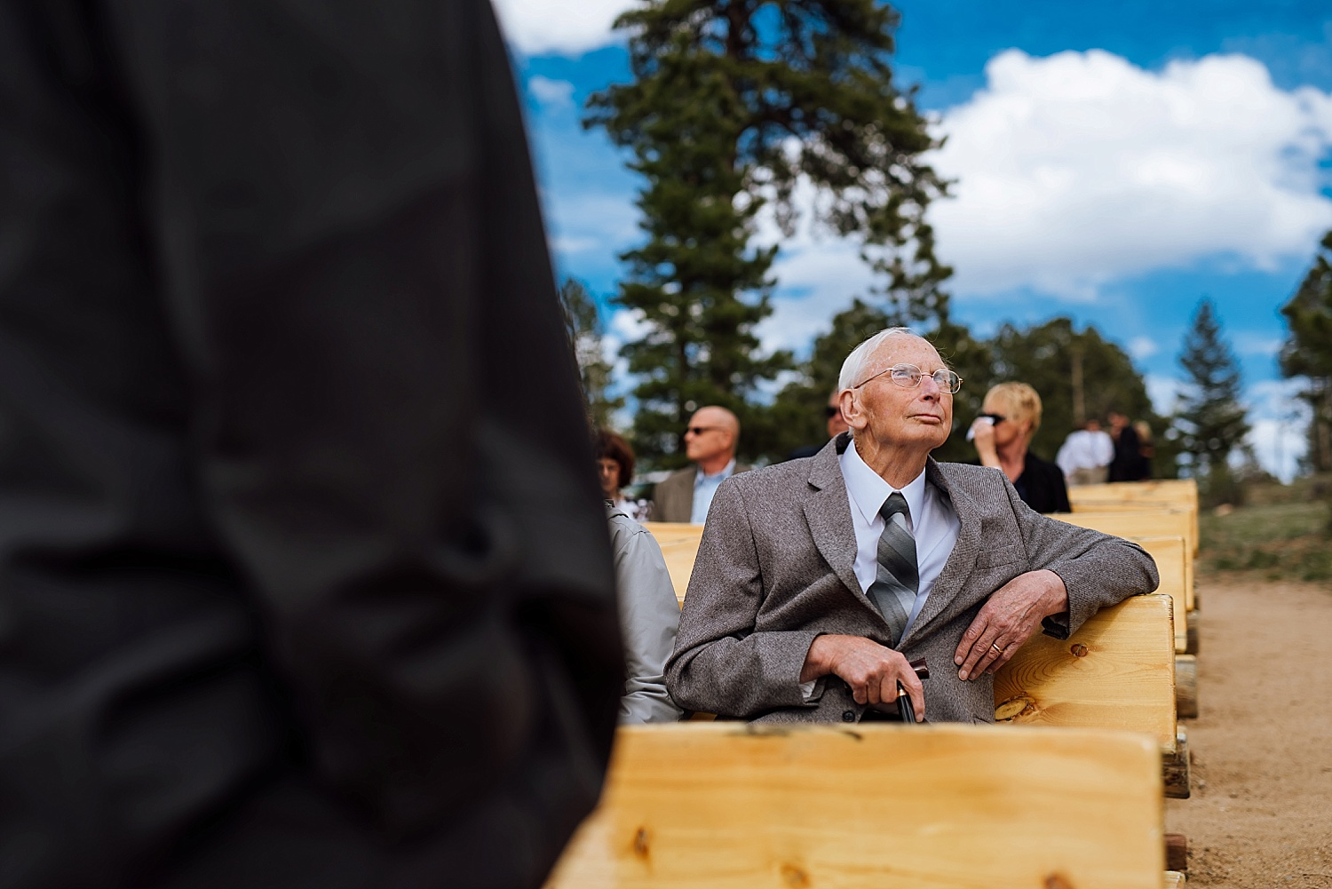 This photo is so cute- this older man looking off at the mountains at a wedding in Estes Park. Photo by Maddie Mae Photography