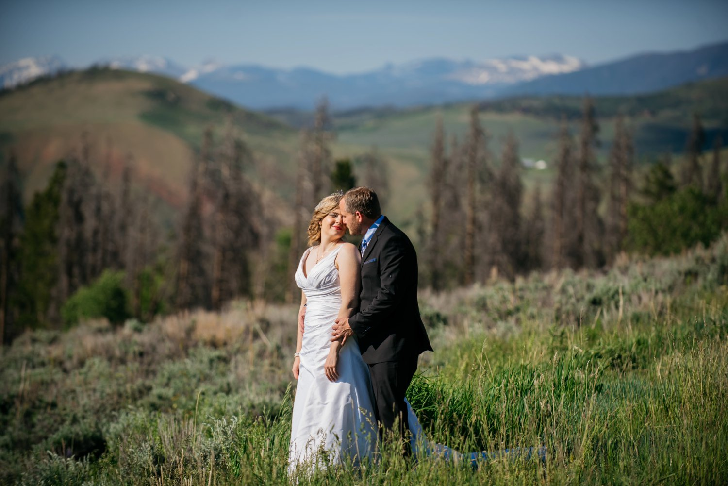 Colorado is so beautiful in the Spring/Summer! The perfect place for a mountain wedding -  mean, look how beautiful those hills are! Photo by Maddie Mae Photography