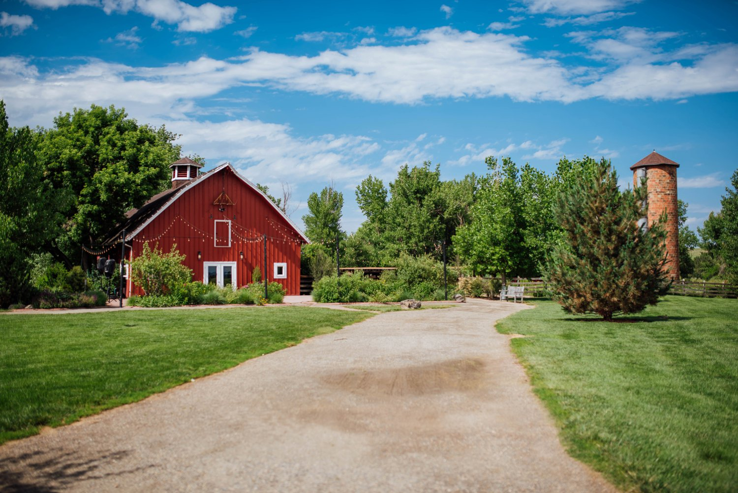 Chatfield farm at the Denver Botanic Gardens at Chatfield is one of the most beautiful wedding venues in Colorado with its signature bright red barn.Photo by Maddie Mae Photography