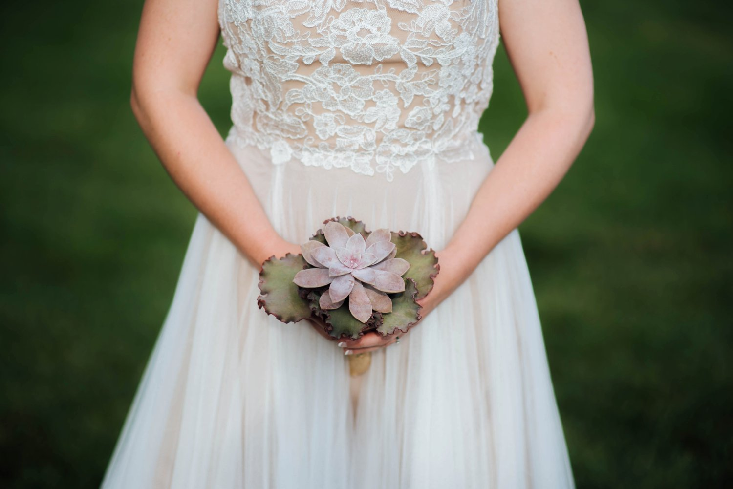 This light pink bouquet is so unique- and goes so well with her lace bodice dress.Photo by Maddie Mae Photography