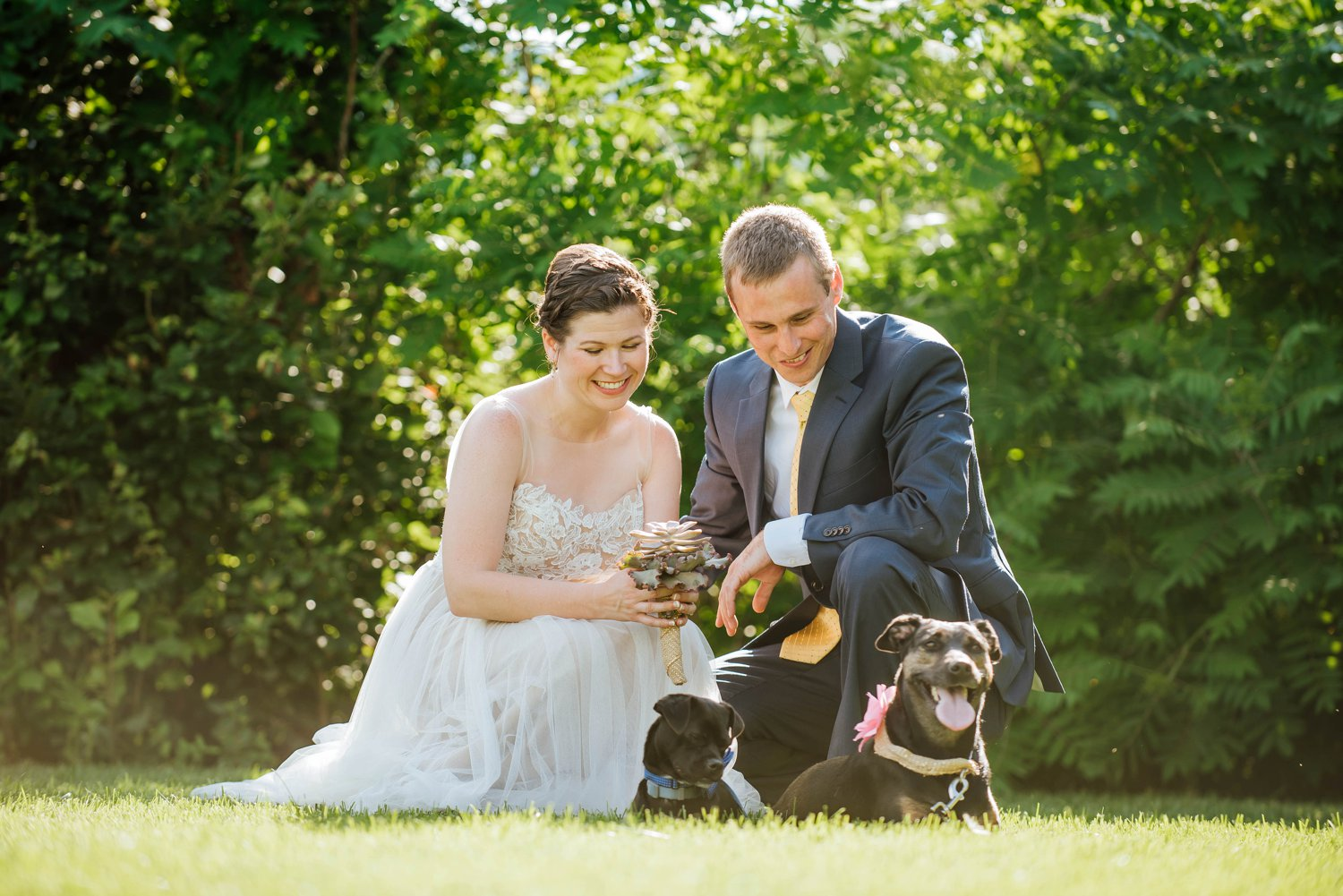 The bride and groom posing with their dogs! i love dog friendly weddings!Photo by Maddie Mae Photography