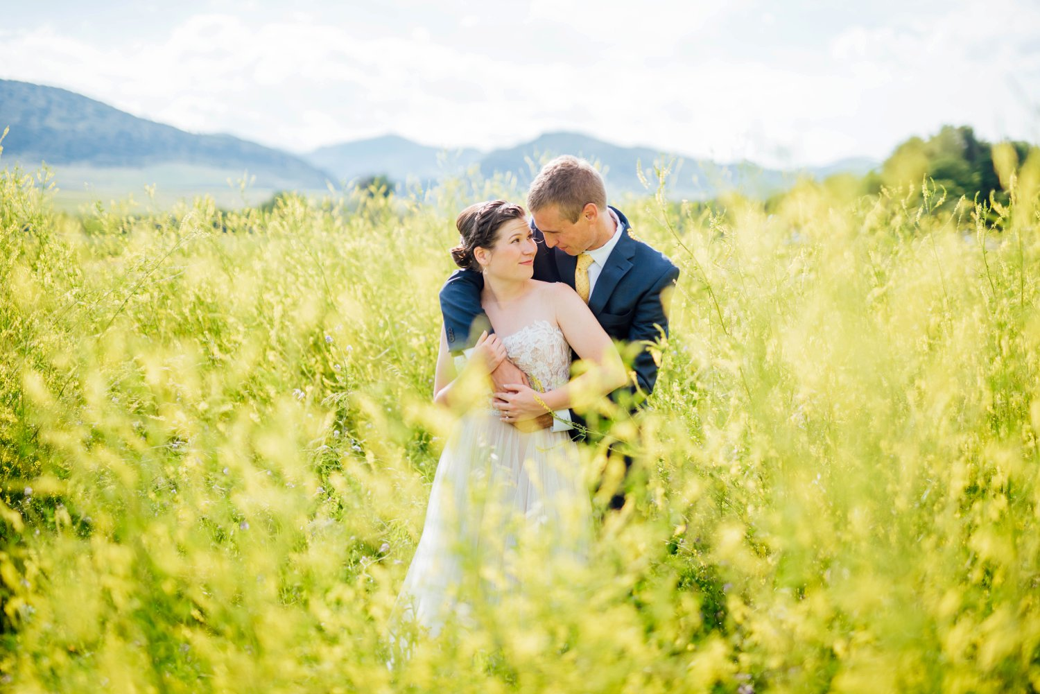 I love this idea of having the bride and groom stand in the field with the tall grass for some of their couple photos. Outdoor weddings are the best!Photo by Maddie Mae Photography