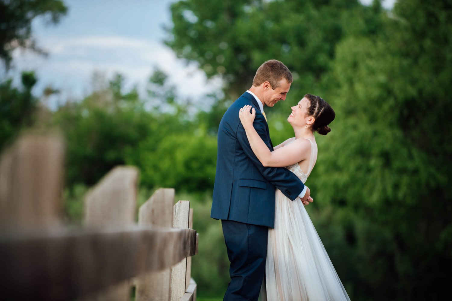 The wooden fences surrounding the Denver Botanic Gardens in Chatfield allows for some great wedding photos!Photo by Maddie Mae Photography