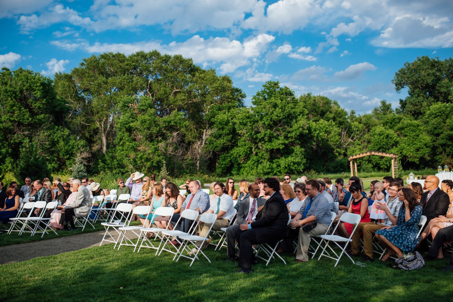 What a perfect wedding day! The right amount of guests and those beautiful blue skies!Photo by Maddie Mae Photography
