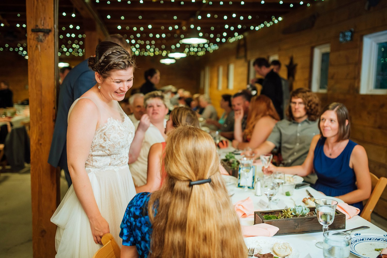 The twinkle lights in this barn reception work so perfectly. The Denver Botanic Gardens at Chatfield is a perfect wedding venue!Photo by Maddie Mae Photography
