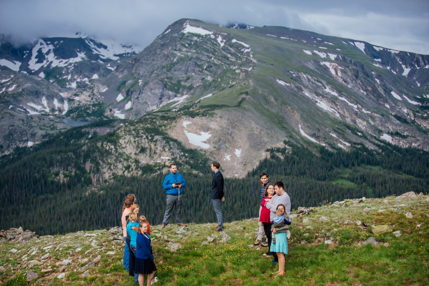 I can't even imagine having a wedding ceremony on the edge of a cliff in Rocky Mountain National Park. Stunning. Photo by Maddie Mae Photography