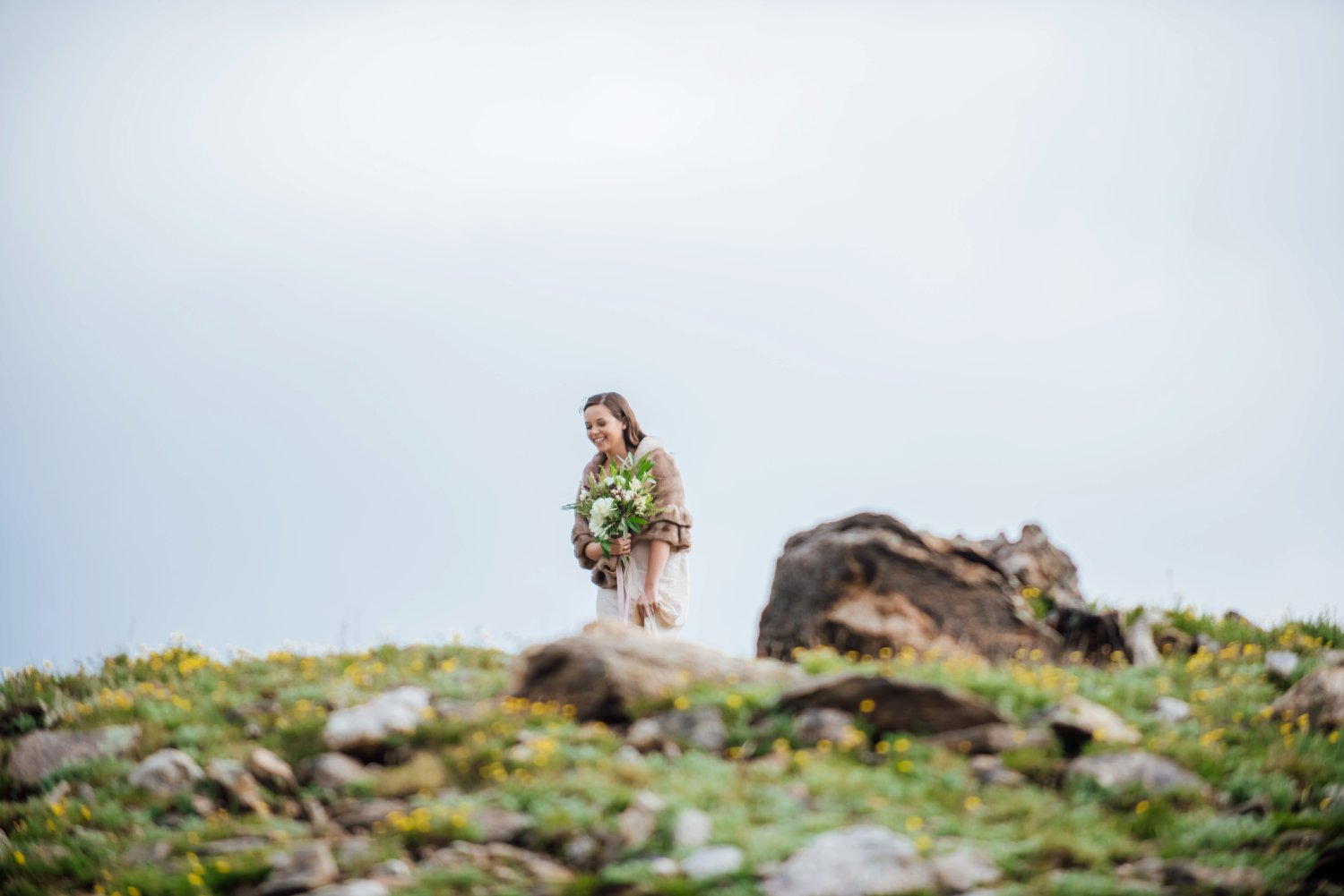 A unique twist on the bride walking down the aisle is having her walk down a mountain. Photo by Maddie Mae Photography