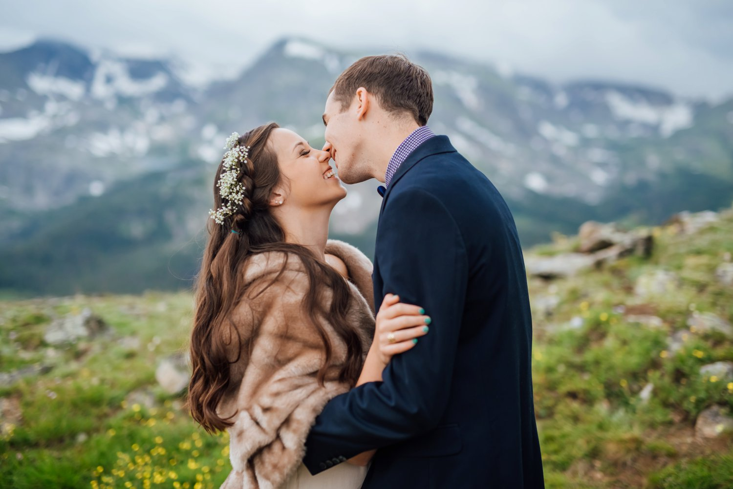 Her fur shawl is absolutely perfect for a colder, mountain wedding. I also love her flower crown. It's subtle and classic. Photo by Maddie Mae Photography