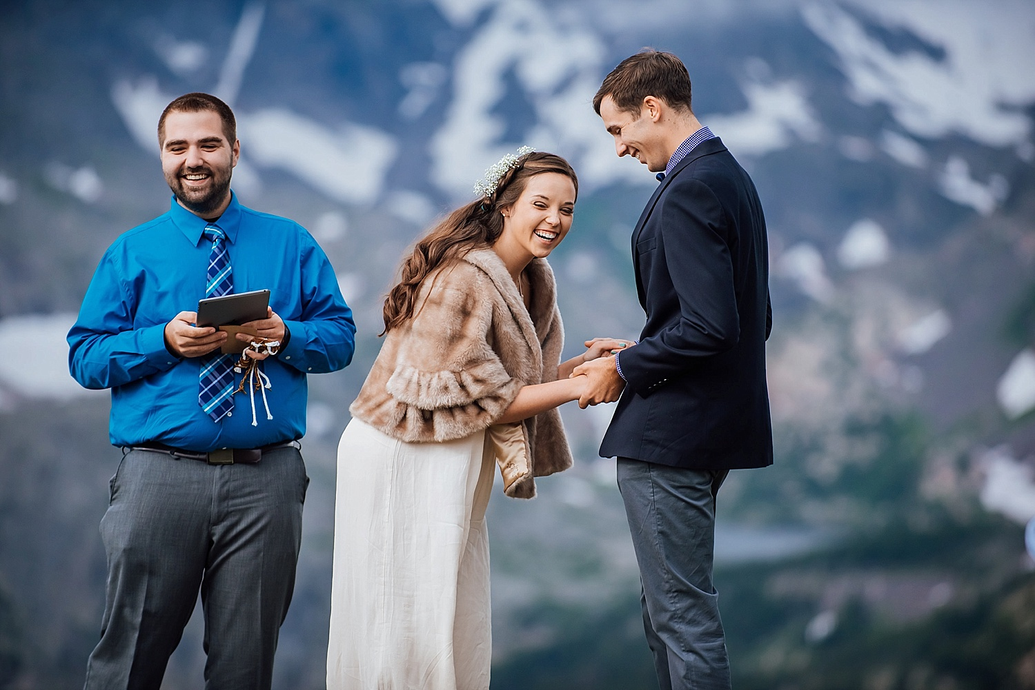 I love this candid ceremony shot during their mountain elopement in Rocky Mountain National Park near Estes Park Colorado. Adventure wedding photographer, Maddie Mae Photography.