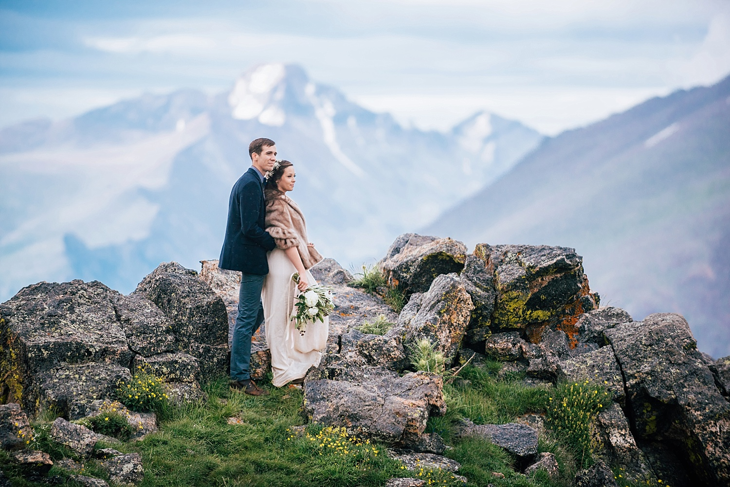 This stunning mountain wedding photo was taken by Maddie Mae Photography near Estes Park Colorado in Rocky Mountain National Park.