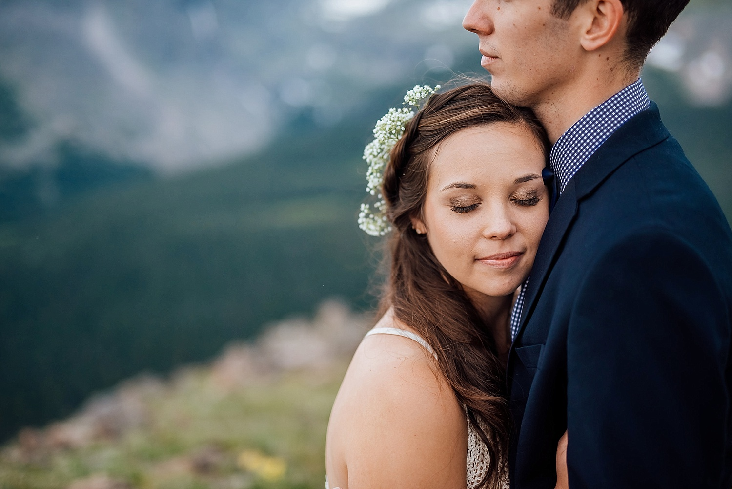 This bride had a beautiful flower crown made for her stunning mountain wedding. Photo by Maddie Mae Photography.