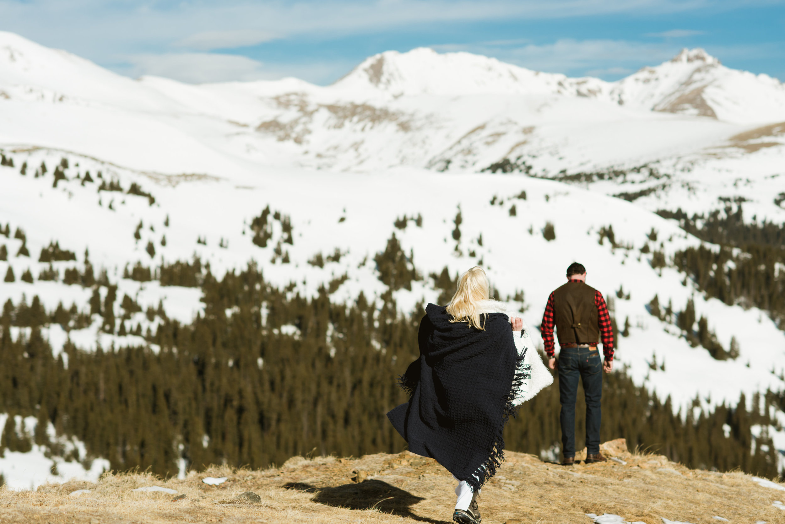 Britta & Colin cozied up on the mountainside where they tied the knot!| Adventurous mountain elopement photography by Maddie Mae