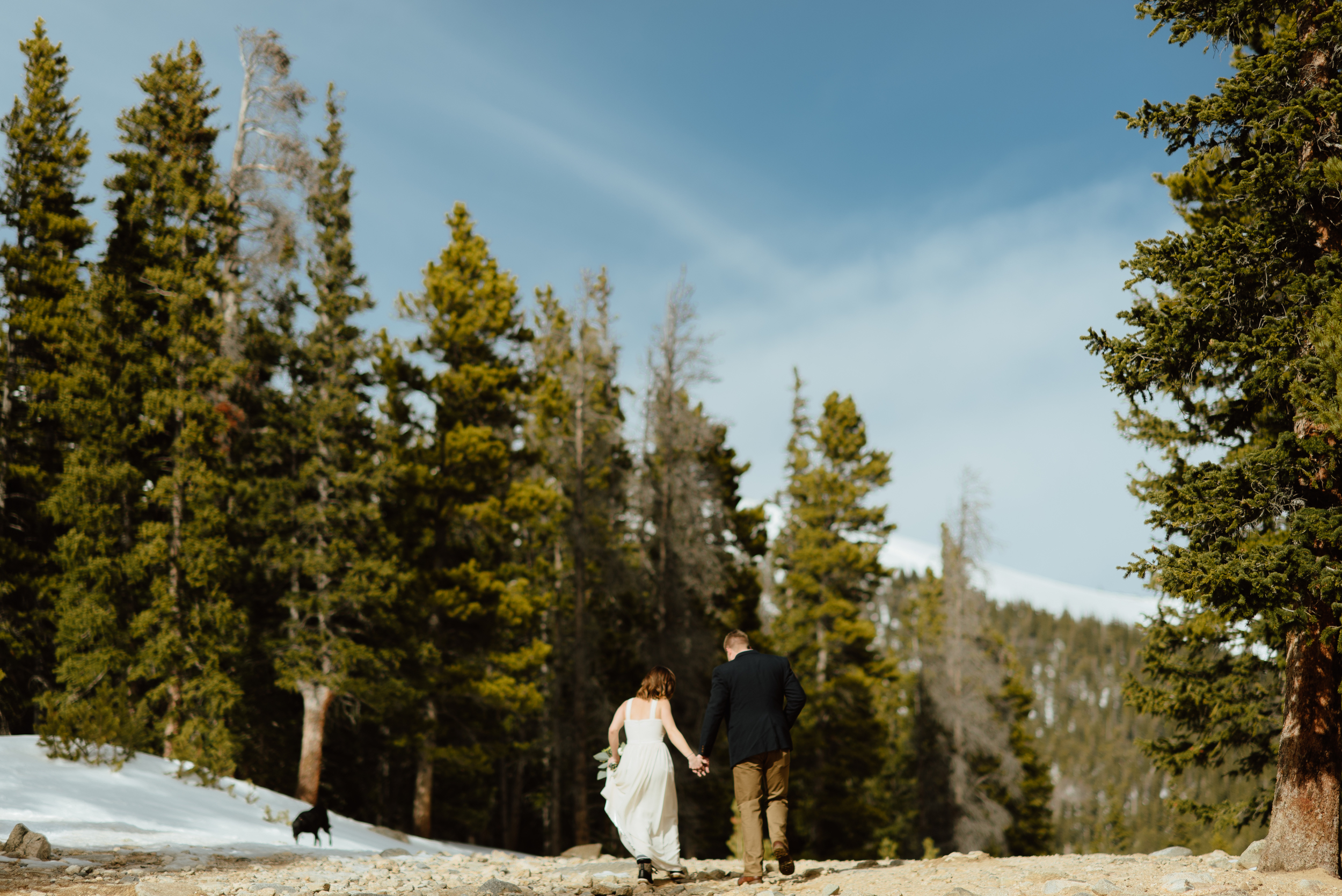 I love the gorgeous, snowy mountain views at St. Mary's Glacier in the winter. What a nice spot in Idaho Springs, Colorado to have my intimate hiking elopement!| Mountain elopement photos by adventure wedding photographer, Maddie Mae.