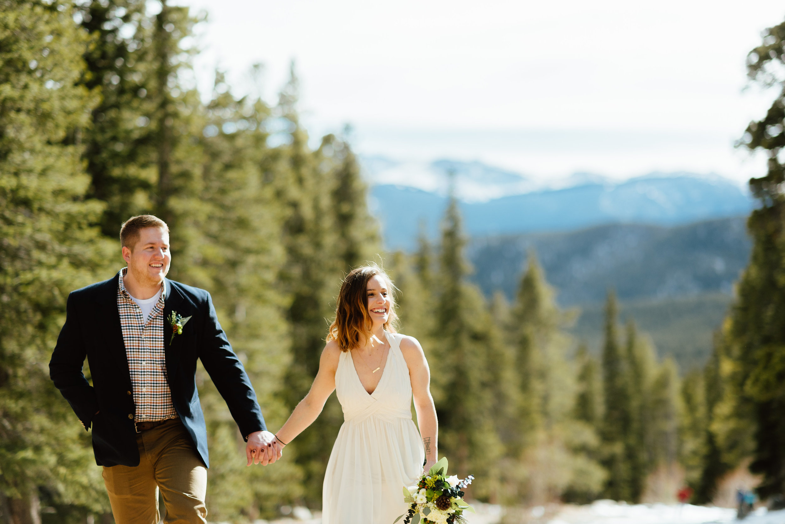 I love how casual this bride and groom's wedding attire is. His casual, hipster plaid shirt looks great next to her flowy ivory dress!| Intimate wedding photos by mountain elopement photographer, Maddie Mae.