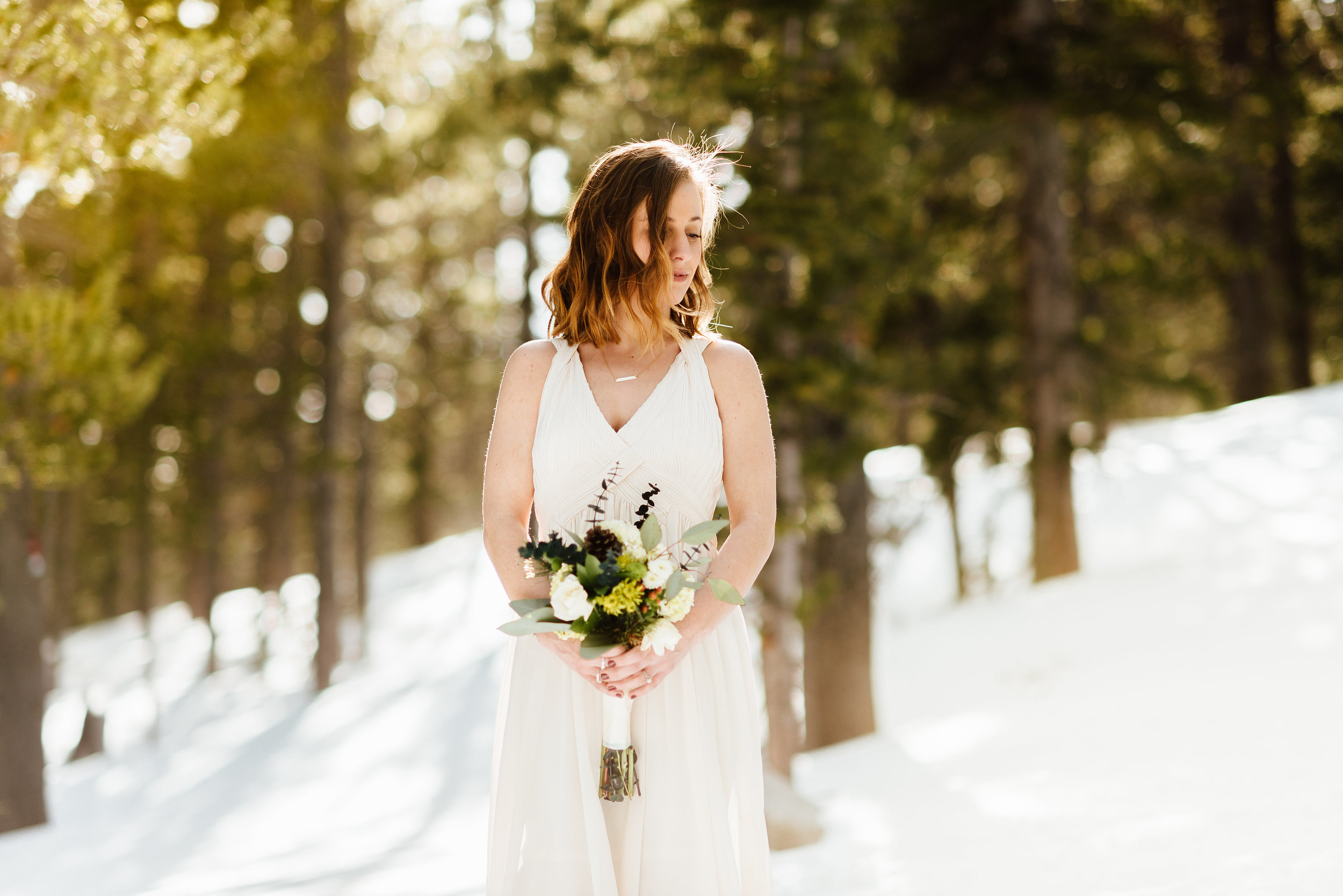 This rustic, mountain bouquet is so gorgeous. Love the hints of sage green and yellow mixed in with the wild, white roses!| Mountain elopement photos by adventure wedding photographer, Maddie Mae.
