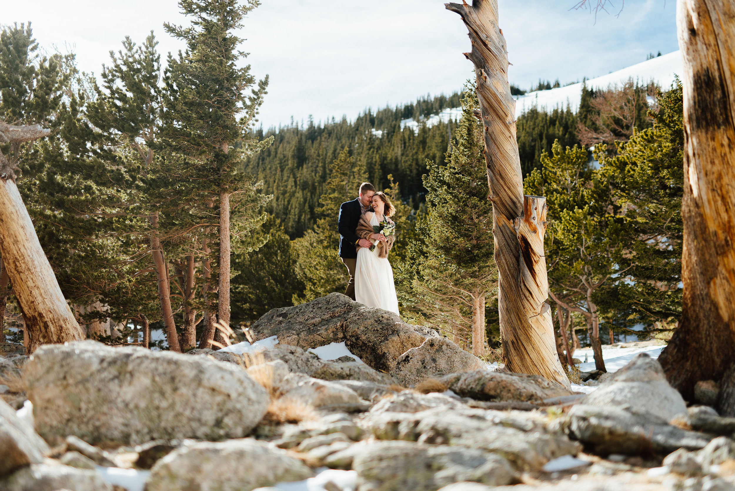 Such an intimate moment between this bride and groom captured in Idaho Springs, Colorado. I love the way this couple is nestled in the whimsical trees of the Rocky Mountains. |Mountain elopement photos by adventure wedding photographer, Maddie Mae.