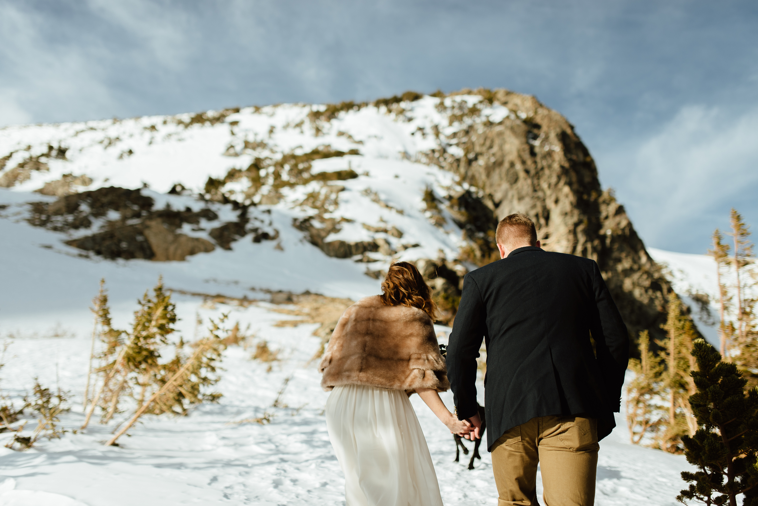 I love the idea of an intimate, hiking elopement way up in the Mountains! Kelsie looks so warm wrapped in that amazing fur shawl over her flowy, ivory wedding dress.| Colorado mountain elopement photos by intimate, wedding photographer, Maddie Mae.