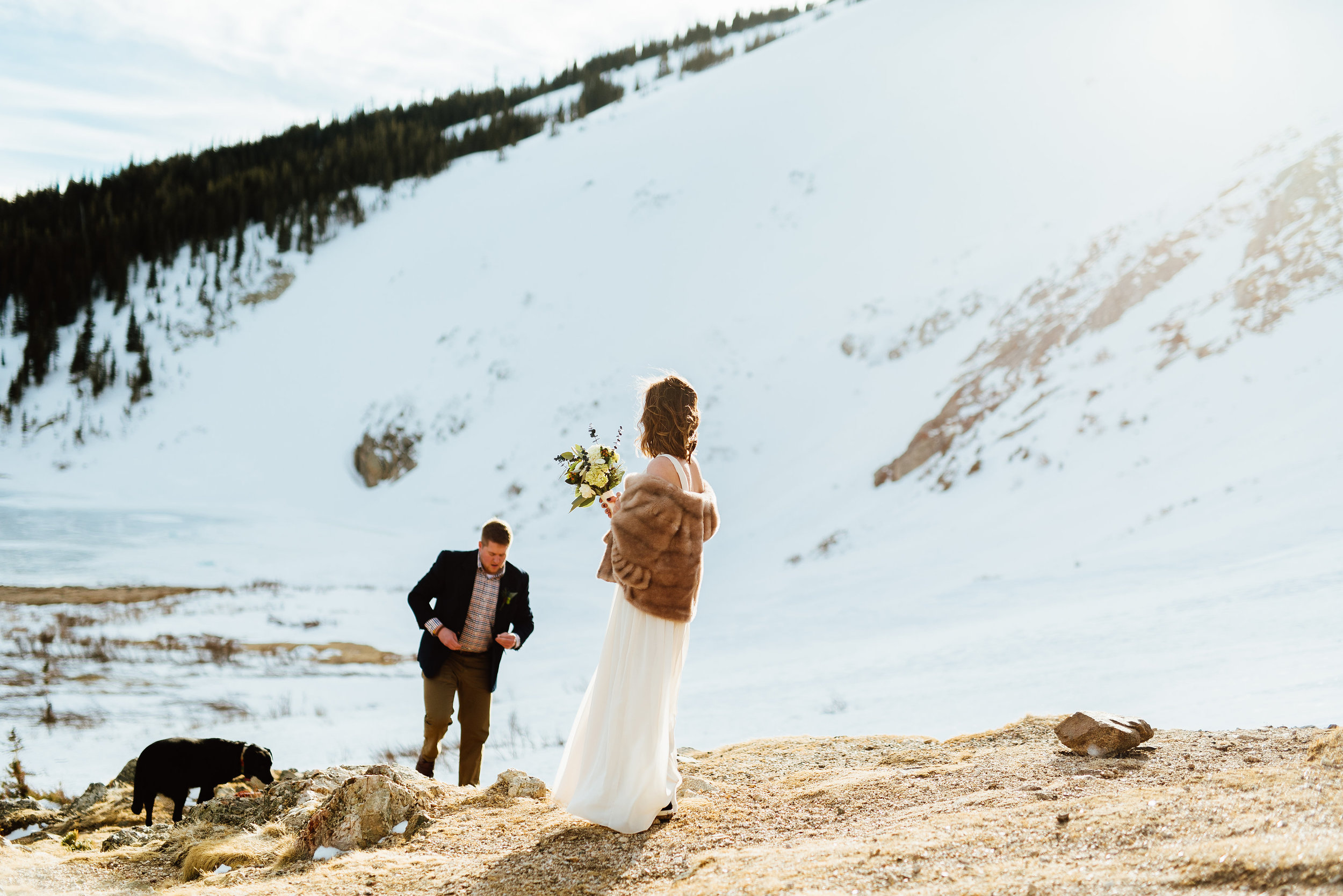 I love this gorgeous view on St. Mary's Glacier in Idaho Springs, Colorado. It's such a gorgeous and wild outdoor ceremony spot perfect for a winter wedding.| Intimate mountain wedding photos by outdoor elopement photographer, Maddie Mae.