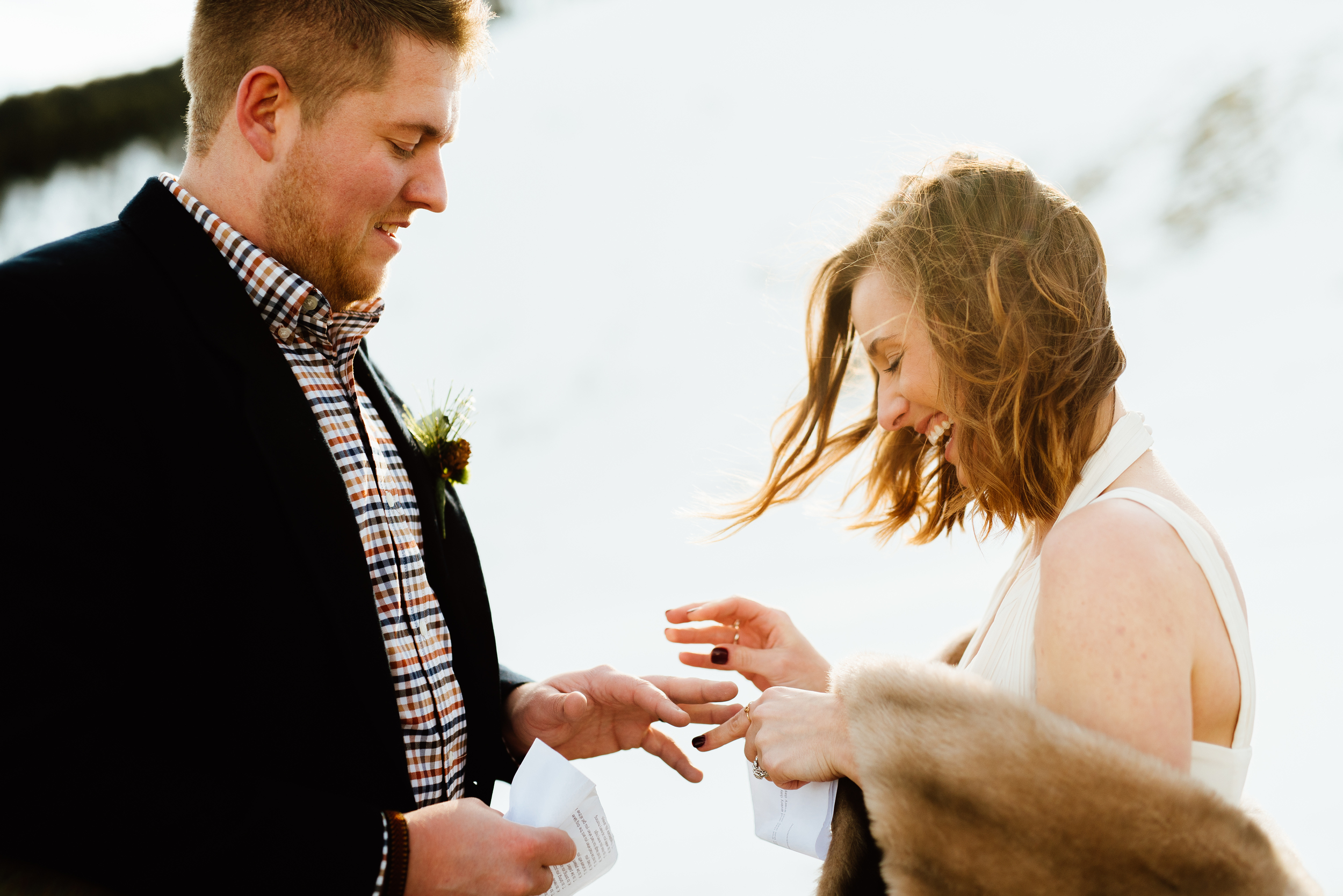 What a fun little snowy wedding ceremony up in the Rocky Mountains! I love Kelsie's fur shawl she is wearing over that gorgeous ivory wedding dress.| Intimate wedding photos by outdoor mountain elopement photographer, Maddie Mae.