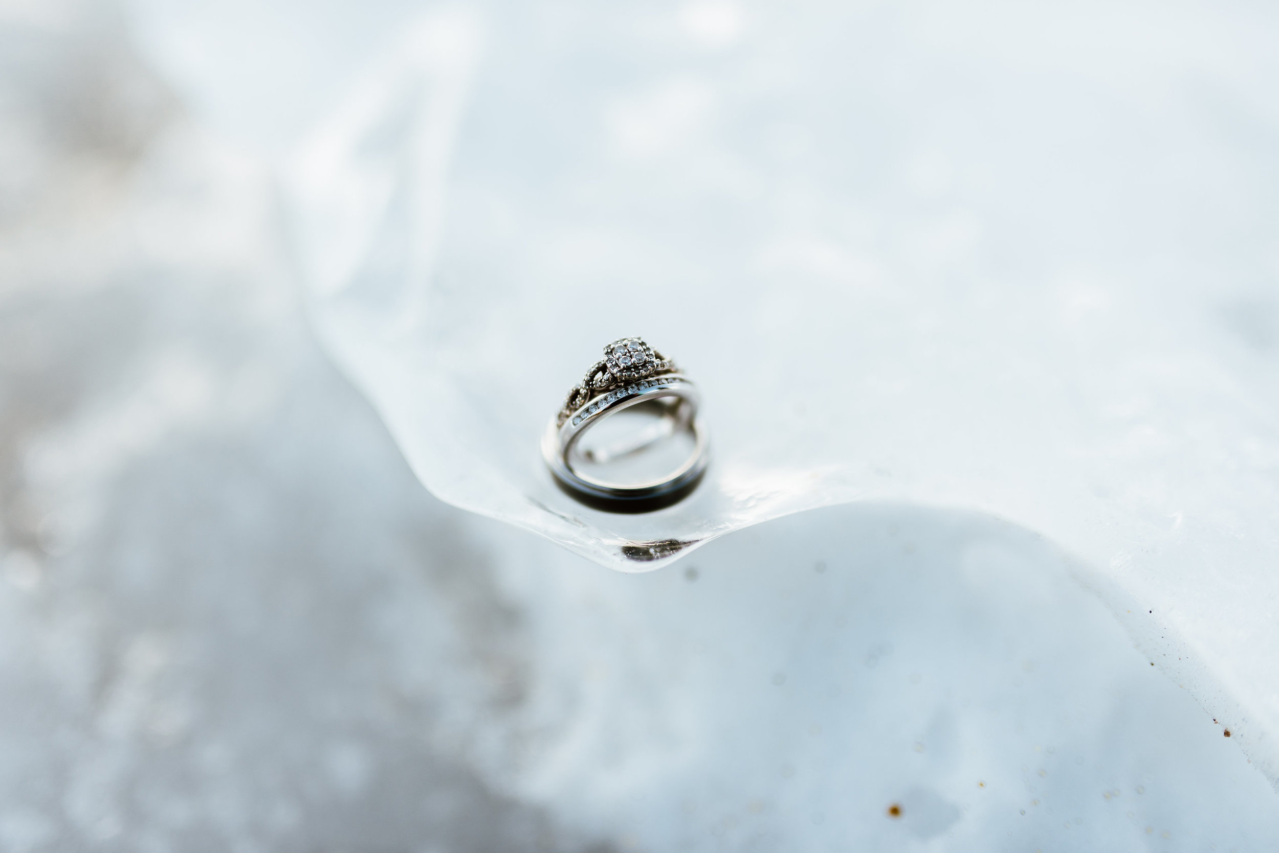What a gorgeous engagement ring and wedding band set! I love the silver wedding bands against the icy background of St. Mary's Glacier!| Mountain wedding photos by intimate, Colorado elopement photographer, Maddie Mae.