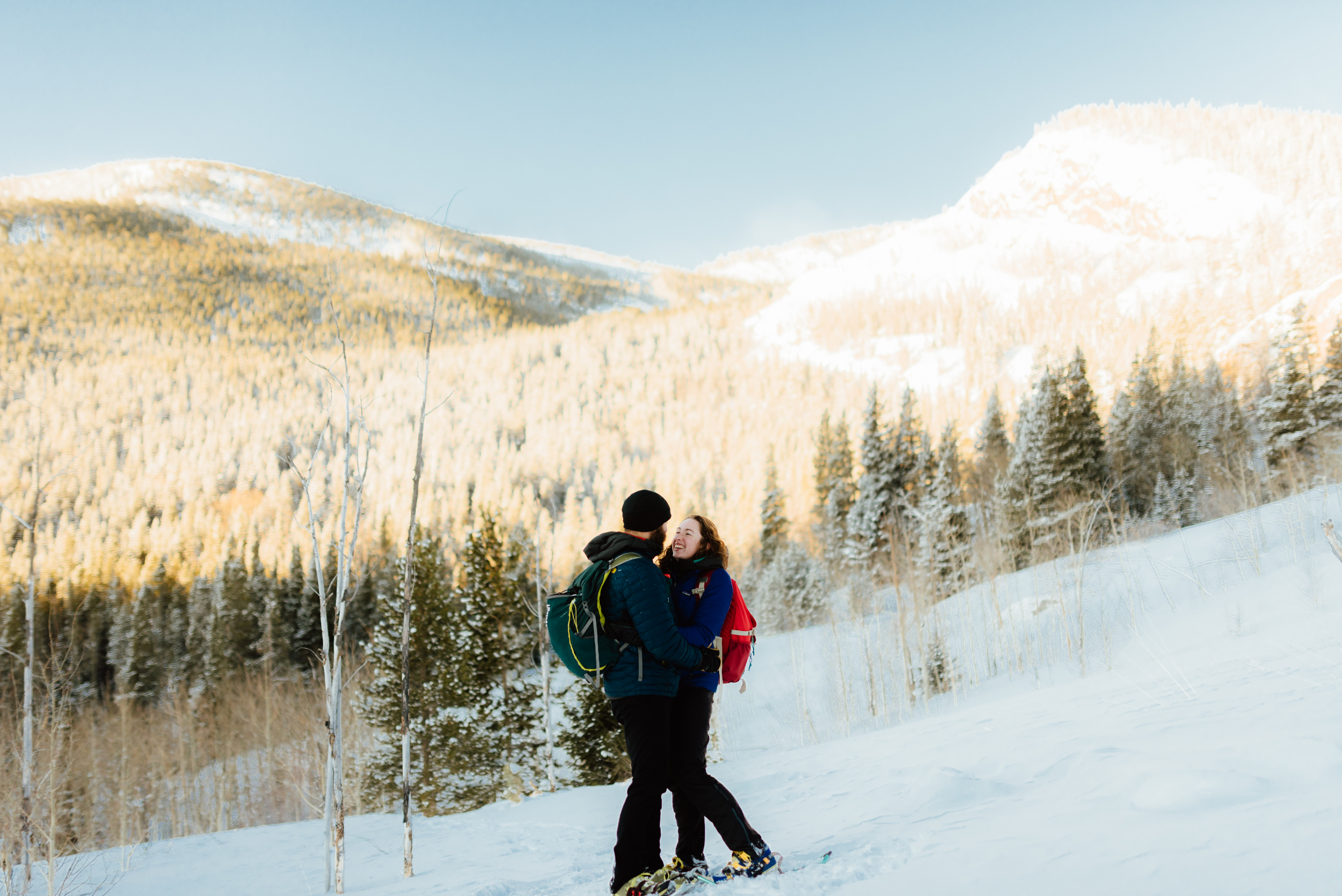 How romantic is this snowy mountain scenery? I love that Hannah and Nick did something really fun like snowshoeing for their engagement photos! Lost Lake in Colorado is such a beautiful location for pictures.| Rocky Mountain engagement photos by adventurous Colorado wedding photographer, Maddie Mae.