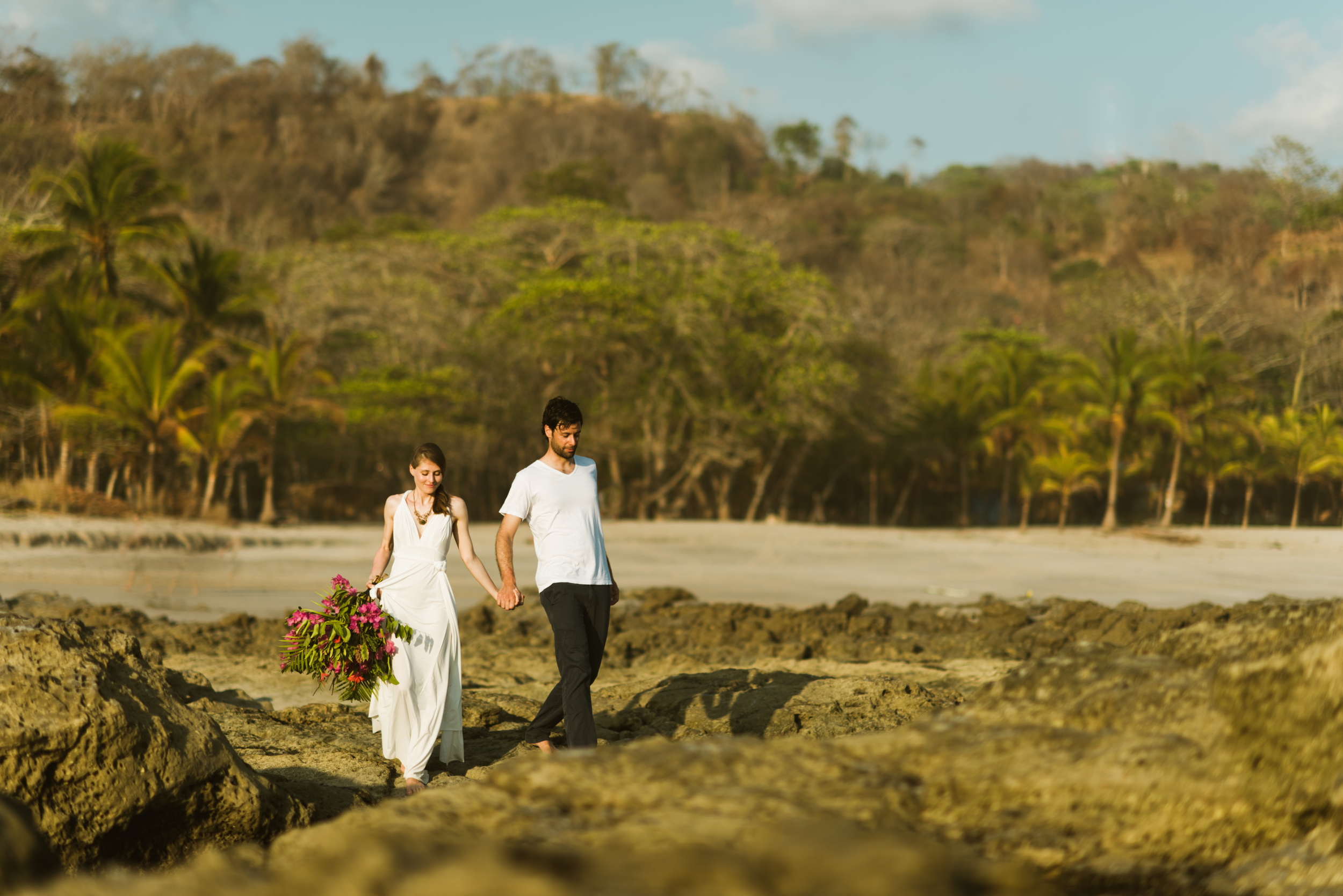 """I absolutely love the scenery around Mal Pais on Santa Teresa Beach in Costa Rica! A destination elopement on a beach is exactly how I want to say """"I Do!"""".   Destination elopement photography by adventure wedding photographer, Maddie Mae."""