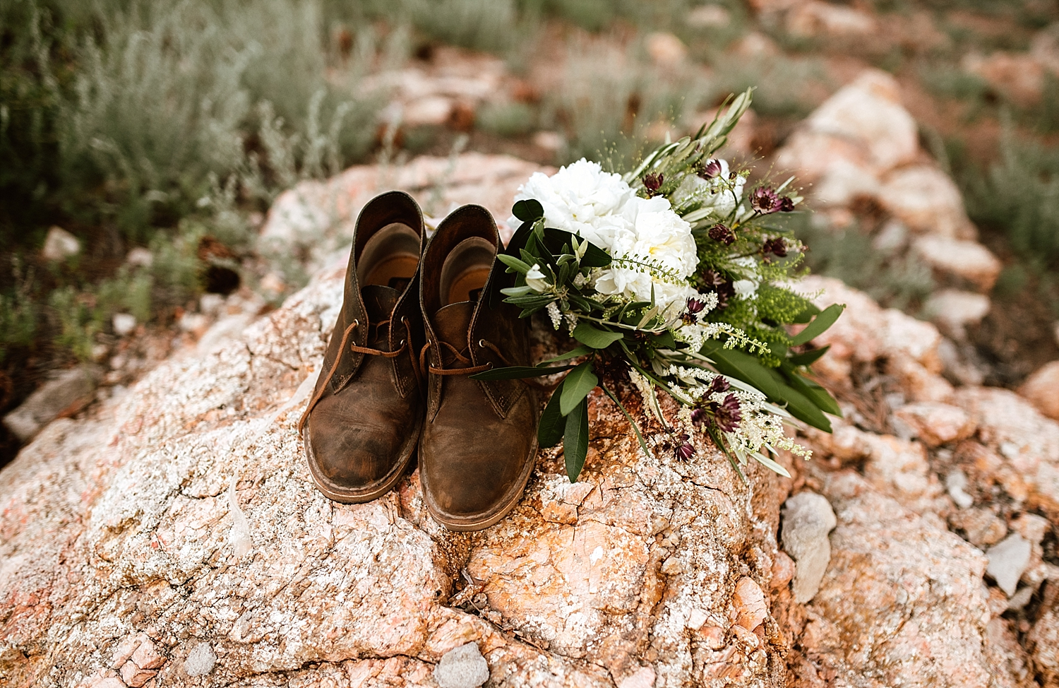 These hipster hiking boots are the perfect wedding shoes for a mountain elopement! And I love that white rose bouquet! | Mountain elopement photos by Rocky Mountain National Park wedding photographer, Maddie Mae.