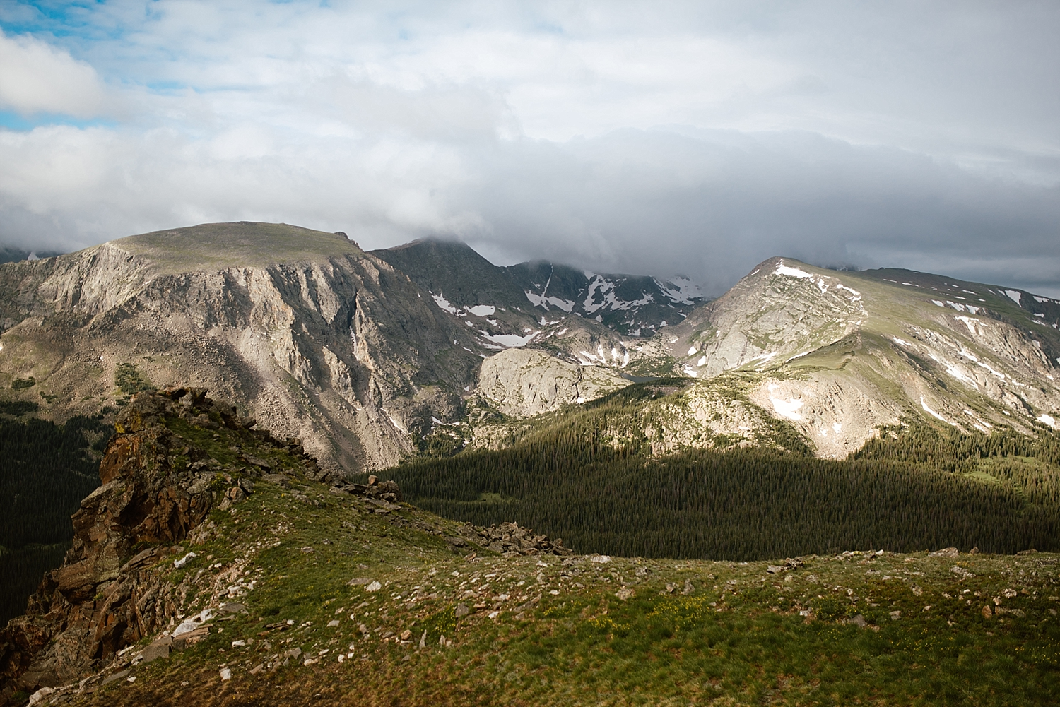 There are some incredible mountain views just off of Trail Ridge Road in Estes Park! What a perfect wedding location! | RMNP elopement photos by adventure wedding photographer, Maddie Mae.