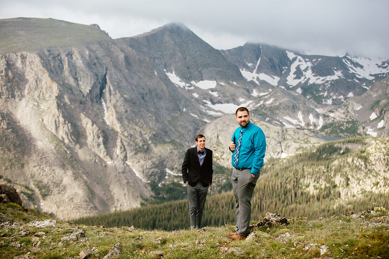 The view of the Rocky Mountains at this intimate mountain elopement is breathtaking! I can't get enough of these Estes Park weddings in Rocky Mountain National Park! | Mountain elopement photos by Trail Ridge Road wedding photographer, Maddie Mae.