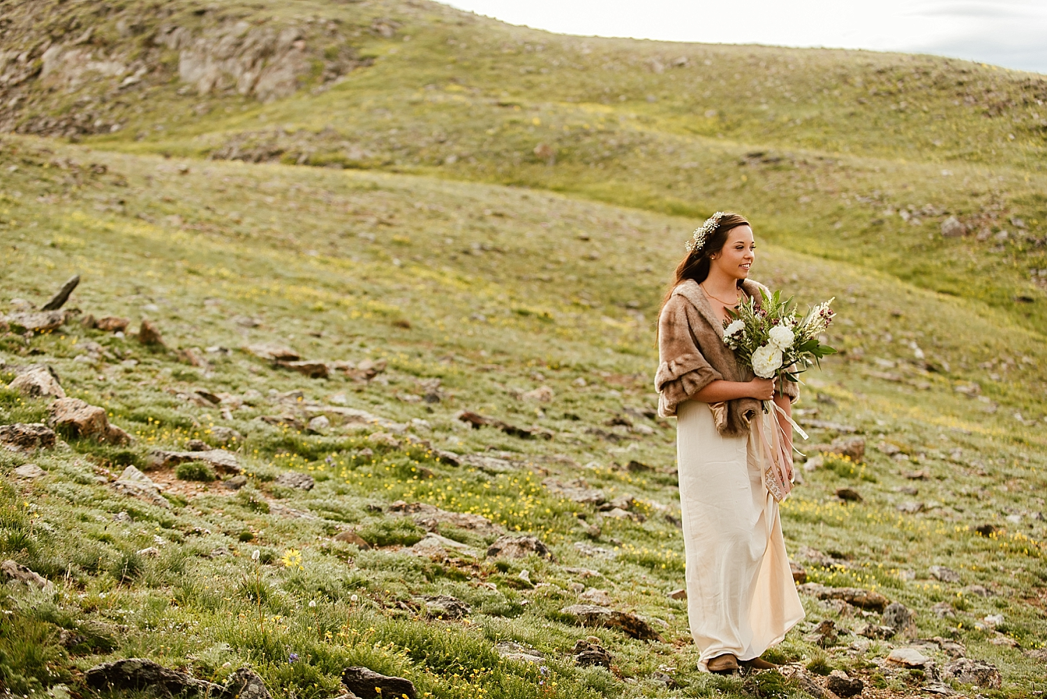 This mountain tundra elopement has to be one of the most rustic, and beautiful mountain weddings I have ever seen! I can't wait to get married in Rocky Mountain National Park near Estes Park, Colorado! | Mountaintop elopement photos by Colorado wedding photographer, Maddie Mae.