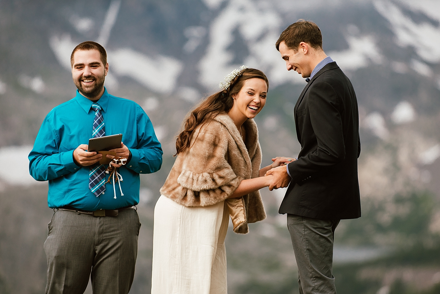 Jessica's fur shawl is absolutely sunning! I love great bridal outfits for a cold mountain wedding day! | RMNP elopement photos by adventure wedding photographer, Maddie Mae.