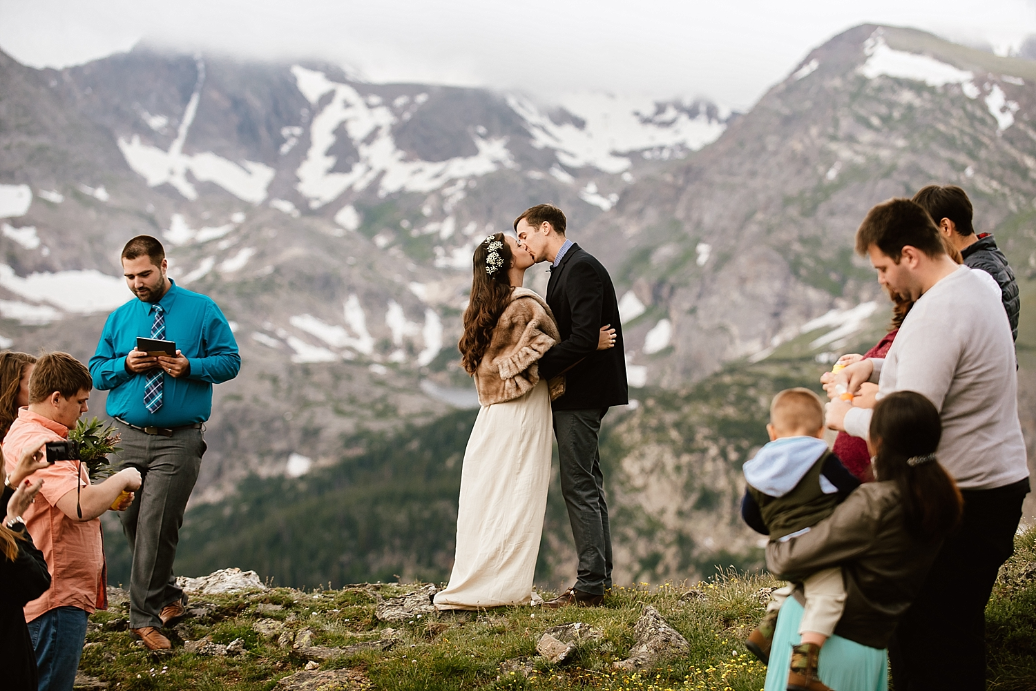 Congratulations to Jessica and Edward after they said their vows on a mountain in Estes Park! I love this winter wedding attire for a gorgeous Rocky Mountain National Park elopement! | RMNP ceremony photos by Estes Park wedding photographer, Maddie Mae.