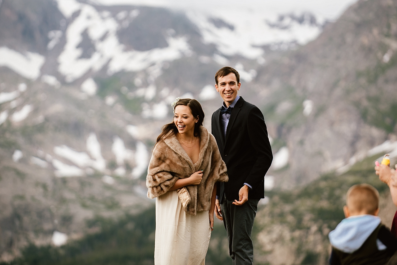 Jessica's adorable vintage fur shawl she's wearing over her wedding dress is so gorgeous! I can't wait for my winter wedding in the mountains! | Trail Ridge Road high alpine elopement photos by Estes Park elopement photographer, Maddie Mae.