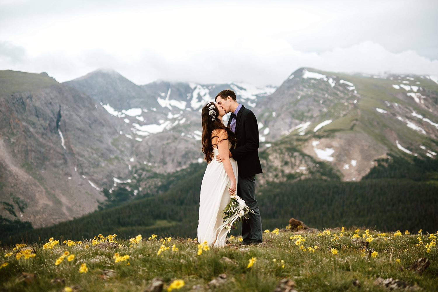Jessica and Edward found this amazing flower field to get some pictures in on their wedding day! Such a great elopement location! | Trail Ridge Road elopement photos by Rocky Mountain National Park wedding photographer, Maddie Mae.