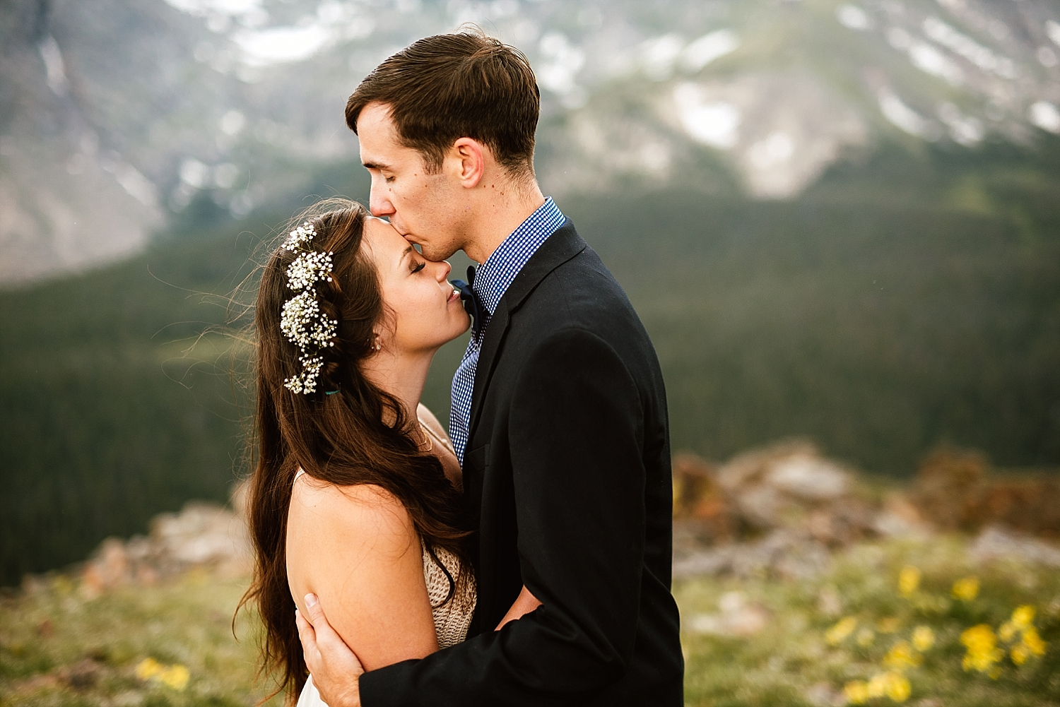 I love this Baby's Breath flower crown Jessica wore in her hair on her wedding day! Such a great wedding hairstyle for long hair like mine! | Mountain elopement photos by adventure wedding photographer, Maddie Mae.