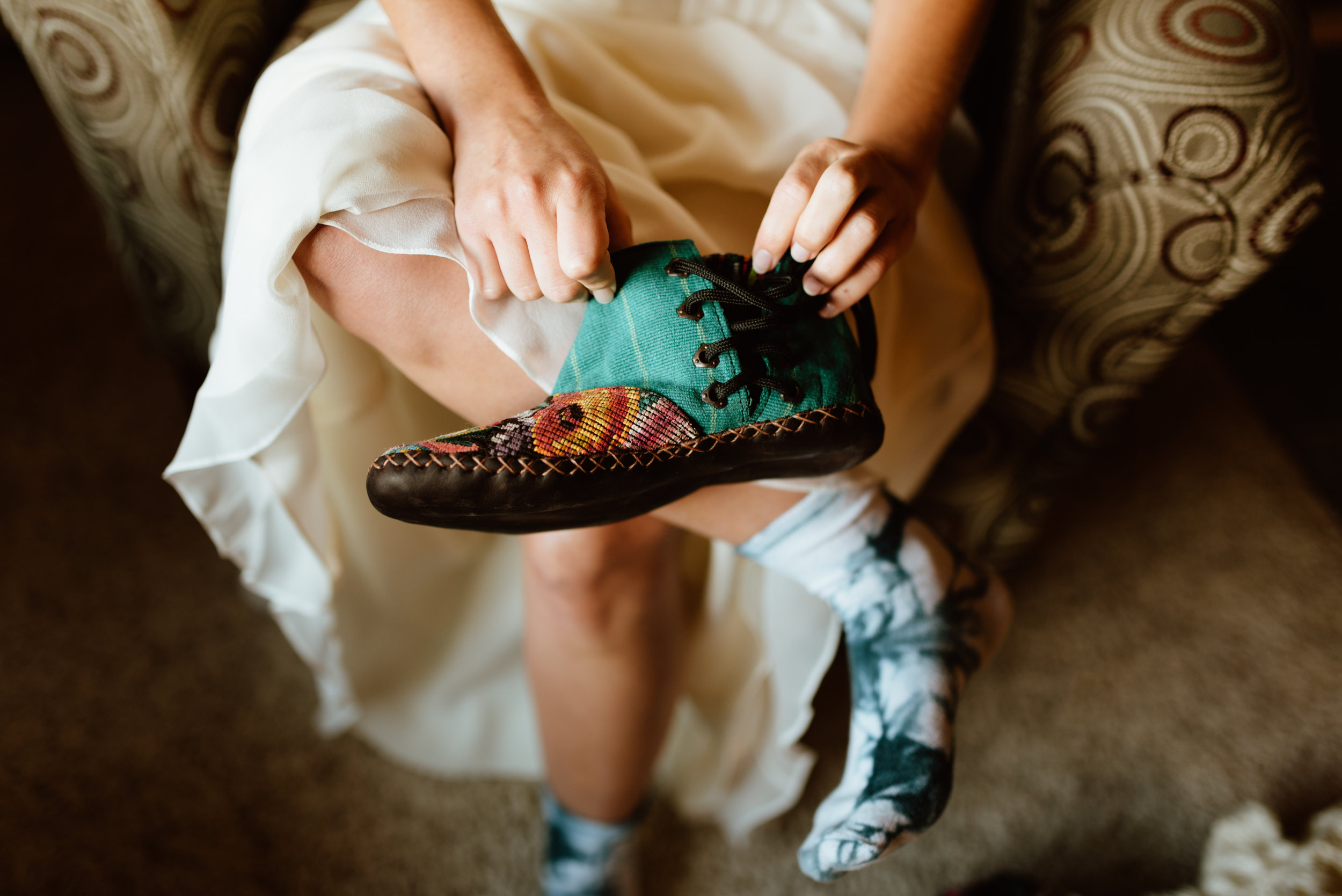 What a great idea to wear moccasins on your wedding day when heels aren't practical like this hiking elopement in RMNP! | Hiking boot wedding photos by Colorado elopement photographer, Maddie Mae.