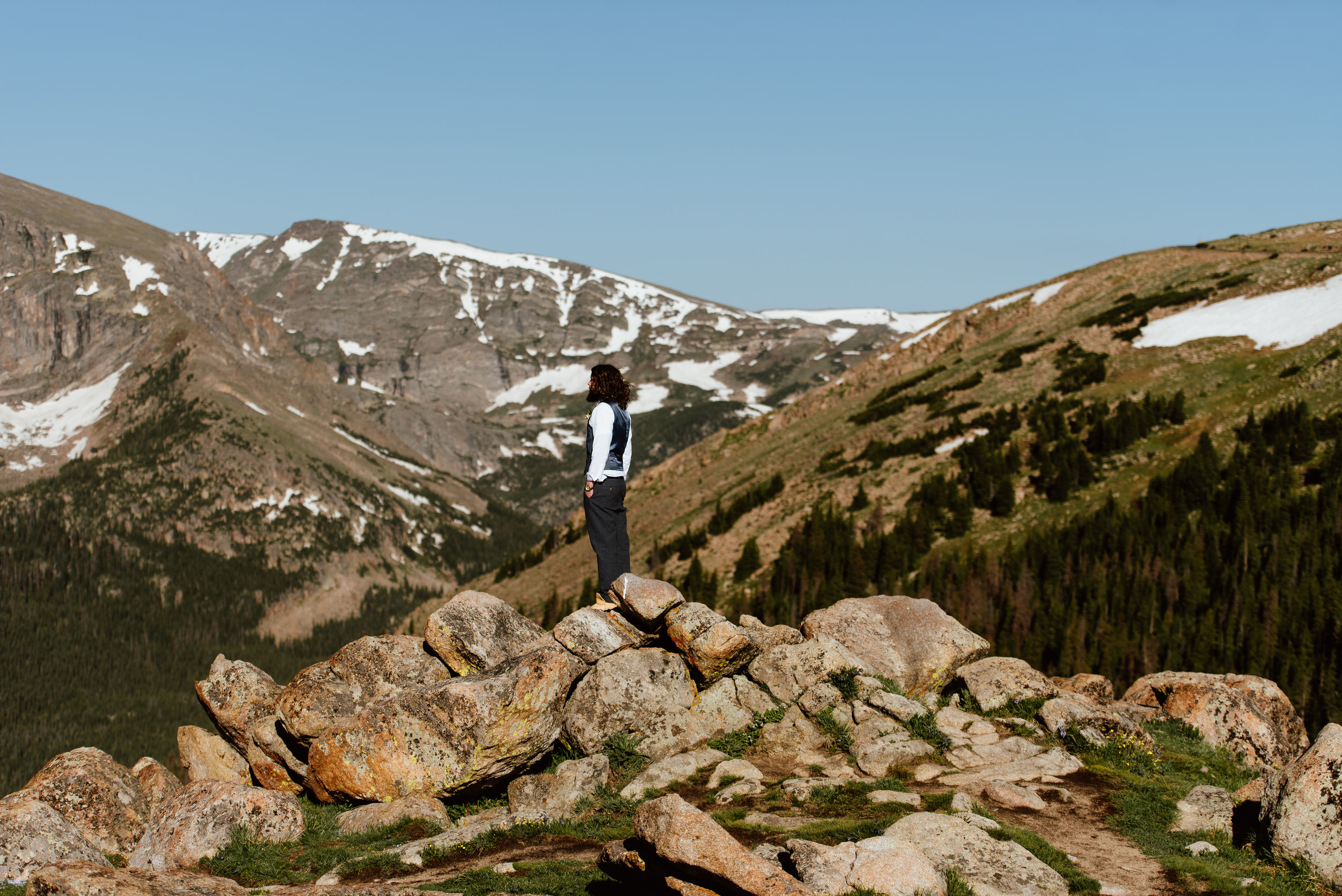 Graham is just getting ready to see his beautiful bride for the first time on this amazing mountaintop! Love these elopement photos! | Intimate mountain elopement photos by Rocky Mountain National Park wedding photographer, Maddie Mae.