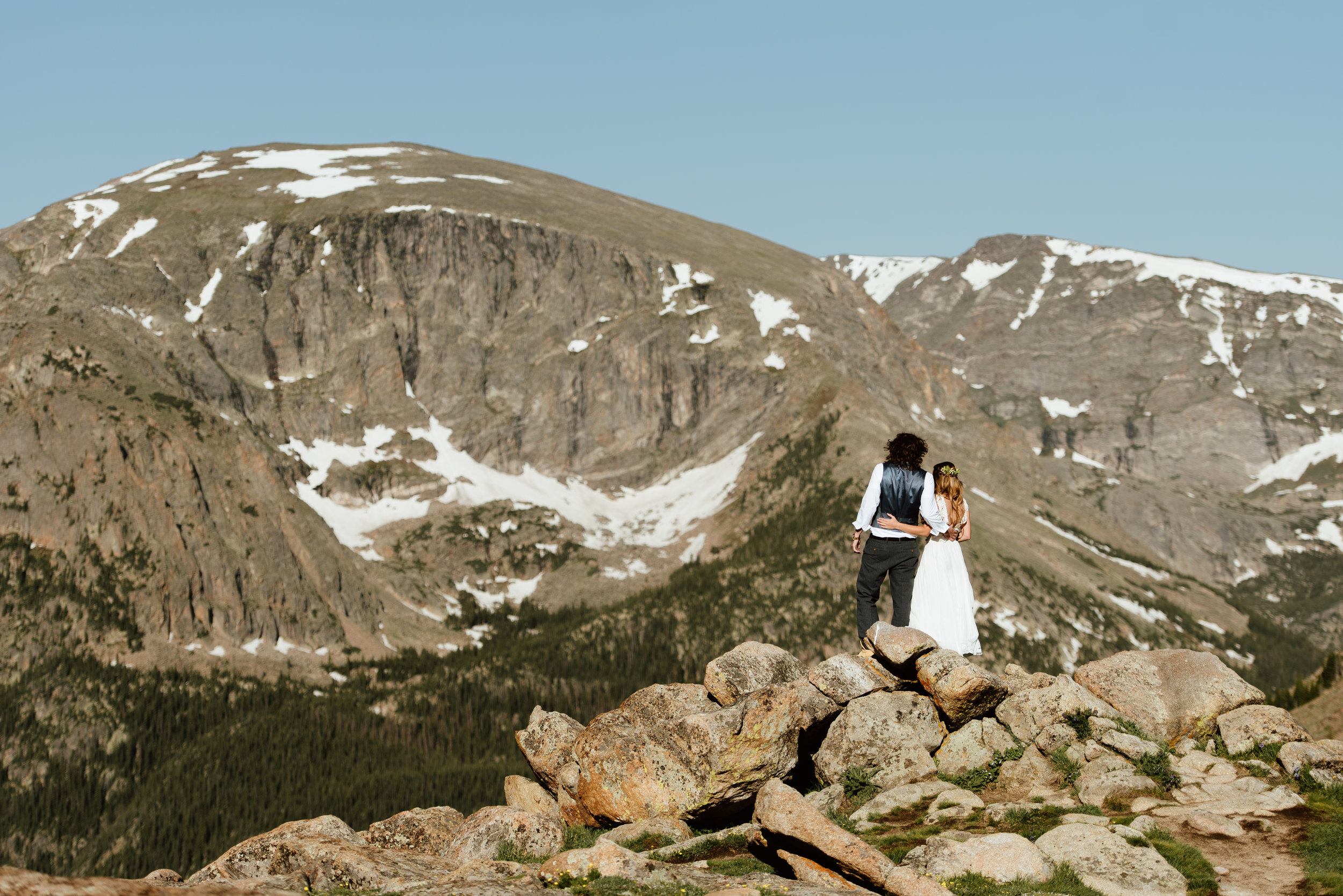 I can't get over how gorgeous this view of RMNP is at Erin and Graham's sunrise mountain hiking elopement! So pretty! | Trail Ridge Road elopement photos by Colorado elopement photographer, Maddie Mae.
