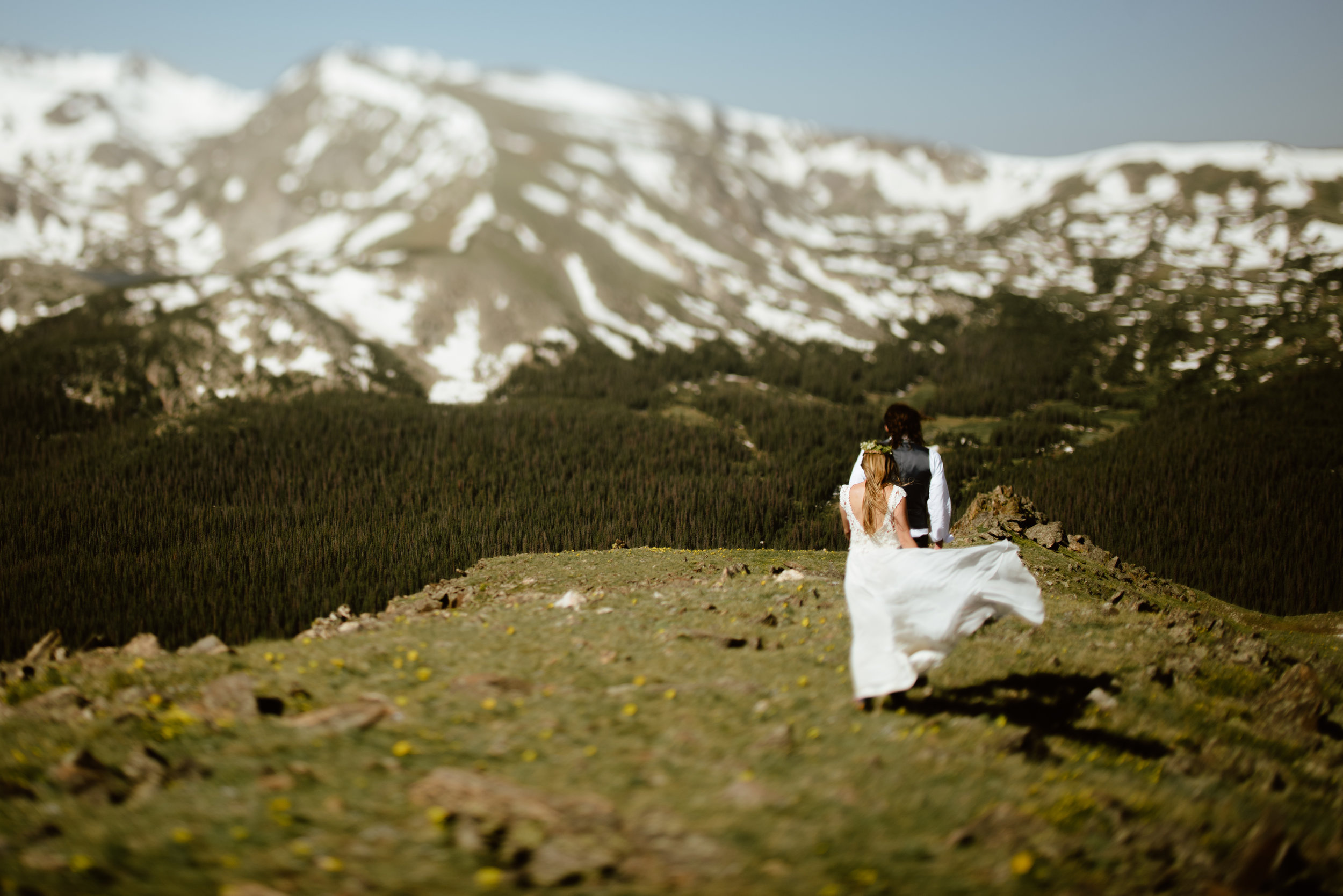 Wow! The view at this elopement location in Rocky Mountain National Park is so incredible! | Trail Rige Road mountain elopement photos by RMNP Colorado wedding photographer, Maddie Mae.