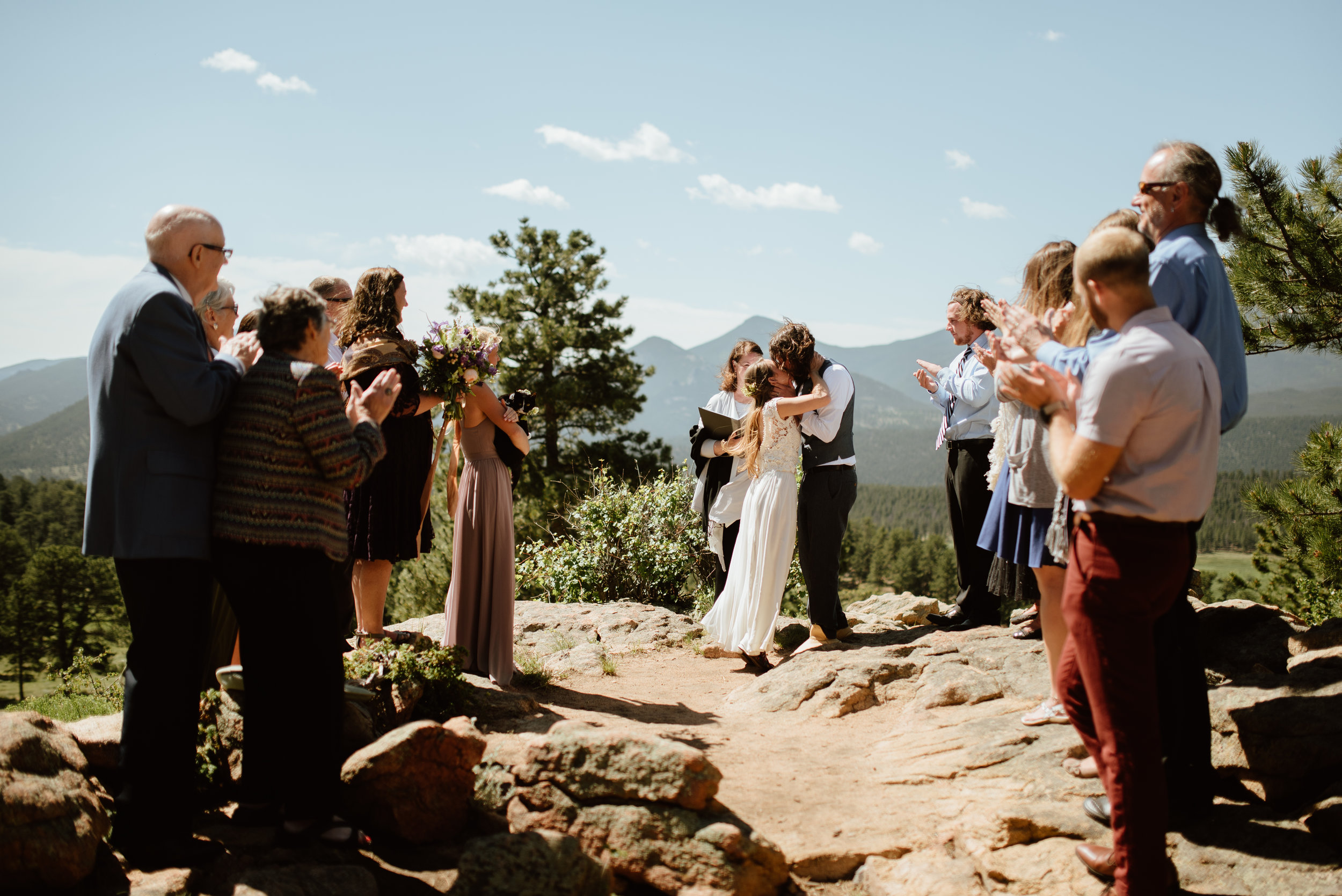 This is such a beautiful wedding ceremony at 3m curve on Trail Ridge Road in RMNP! I can't believe how incredible that mountain view is! | Rocky Mountain National park elopement photos by adventure wedding photographer, Maddie Mae.