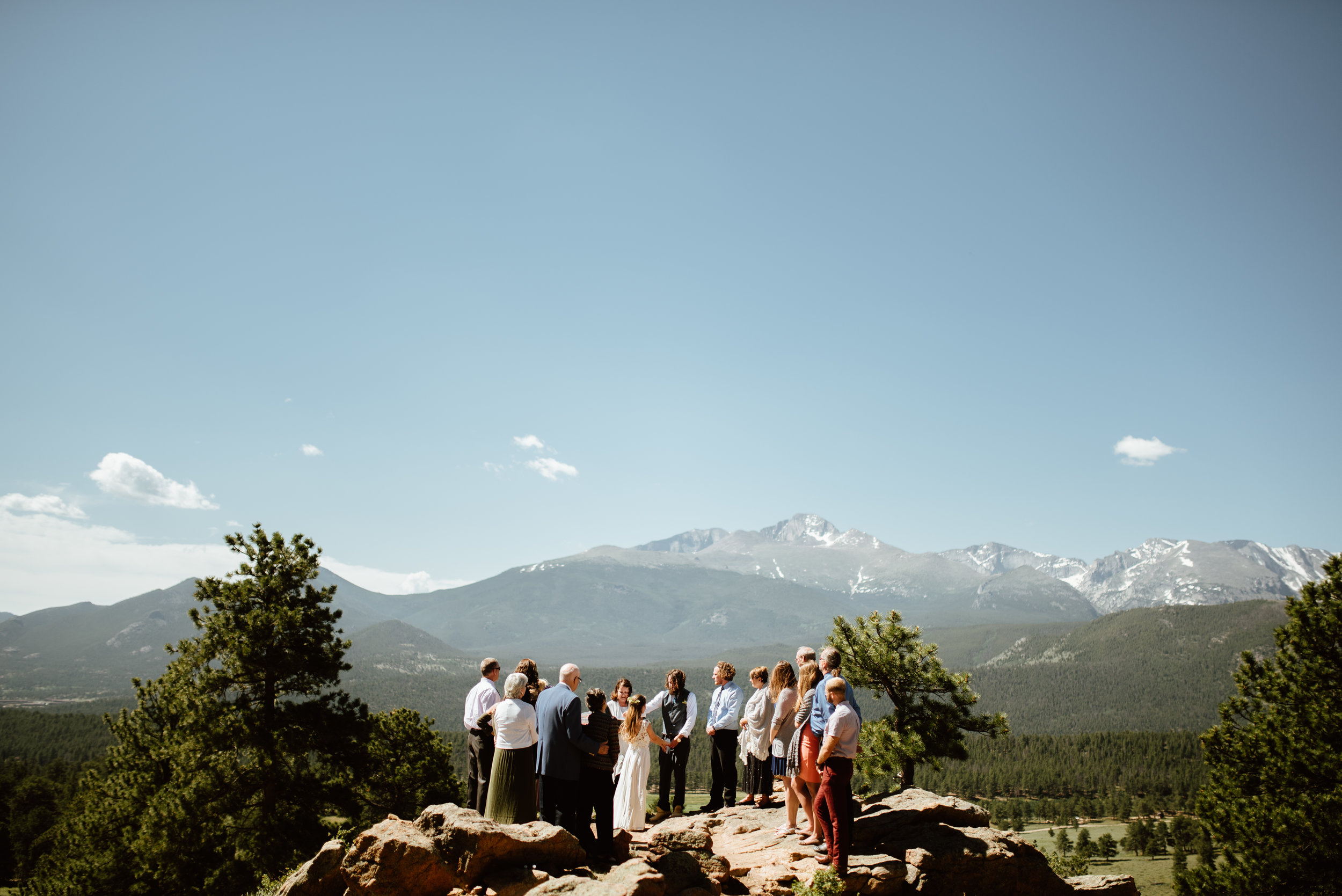 Love this intimate elopement ceremony in the mountains! This 3m Curve wedding ceremony location in Rocky Mountain National Park is just perfect! Congrats to Erin and Graham! | Mountain elopement photos by Rocky Mountain National Park wedding photographer, Maddie Mae.