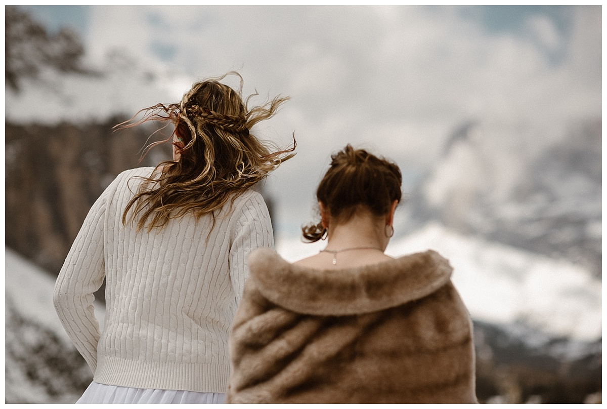 With the wind whipping through their hair these stunning brides continued their hunt for the perfect intimate elopement ceremony location high in the Italian Dolomite Mountains. Captured by Colorado wedding photographer Maddie Mae.