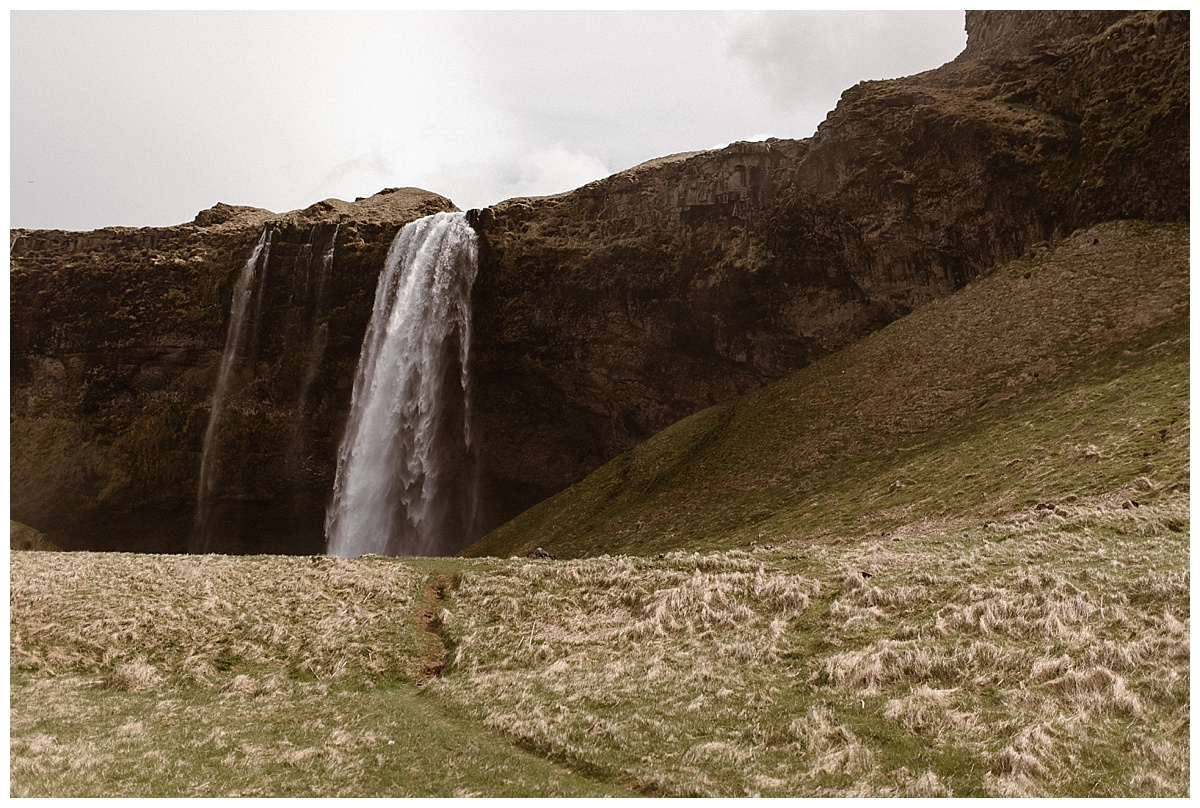 For their first of many locations, they stopped at Seljalandsfoss waterfall in the Icelandic country side. This intimate elopement photographed by traveling wedding photographer Maddie Mae.