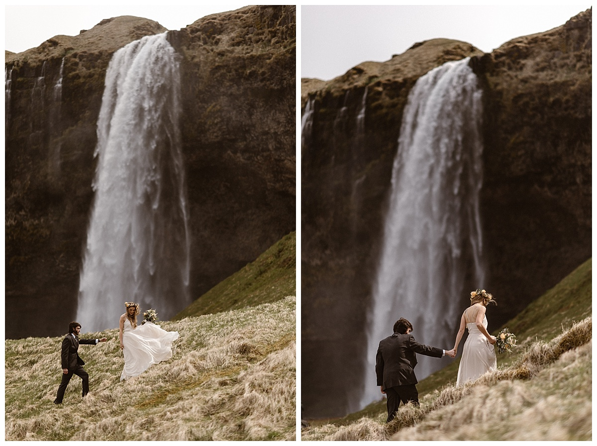 The wind at Seljalandsfoss waterfall picked up Julie's flowing gown as they hiked up the hillside for a better view of this epic Icelandic waterfall. Photos by intimate wedding photographer Maddie Mae.