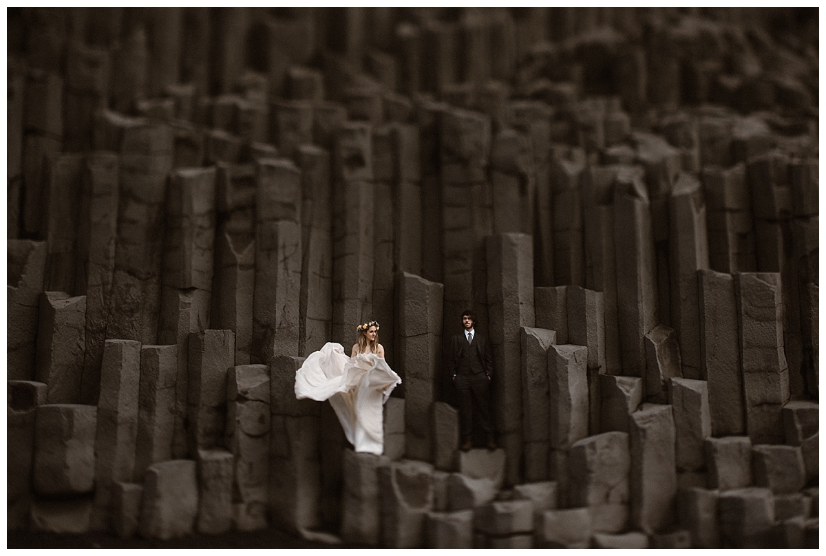 Reynisdrangar beach is home to some of the epic landscapes in Iceland outside of Vic's beach. The wind caught Julie's dress making for the most stunning elopement portrait, captured by traveling wedding photographer Maddie Mae.